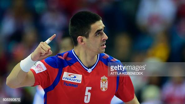 arko eum of Serbia celebrates his score against France during the Men's 2016 EHF European Handball Championships match between Serbia and France in...