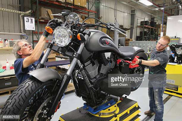 Arlan Reverts and John Elliot put some finishing touches on a 2015 Victory Gunner motorcycle on the assembly line at the Polaris Industries factory...