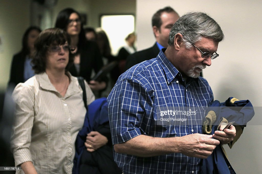 Arlene (L) and Robert Holmes (R), the parents of Aurora theater shooting suspect James Holmes, arrive at the courtroom for a hearing in the Arapahoe County Justice Center on April 1, 2013 in Centennial, Colorado. Prosecutors have said they will seek the death penalty for suspect James Holmes, who is charged with 166 counts of murder, attempted murder and other crimes in the Aurora theater shooting on July 20, 2012.