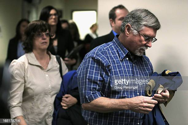 Arlene and Robert Holmes the parents of Aurora theater shooting suspect James Holmes arrive at the courtroom for a hearing in the Arapahoe County...
