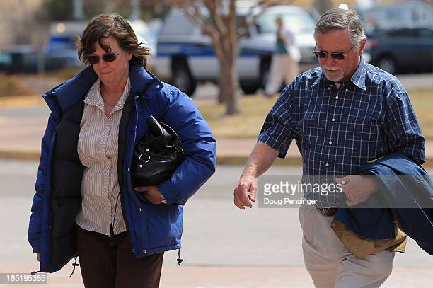 Arlene and Robert Holmes the parents of Aurora theater shooting suspect James Holmes arrive at the court house after a midday recess during a hearing...