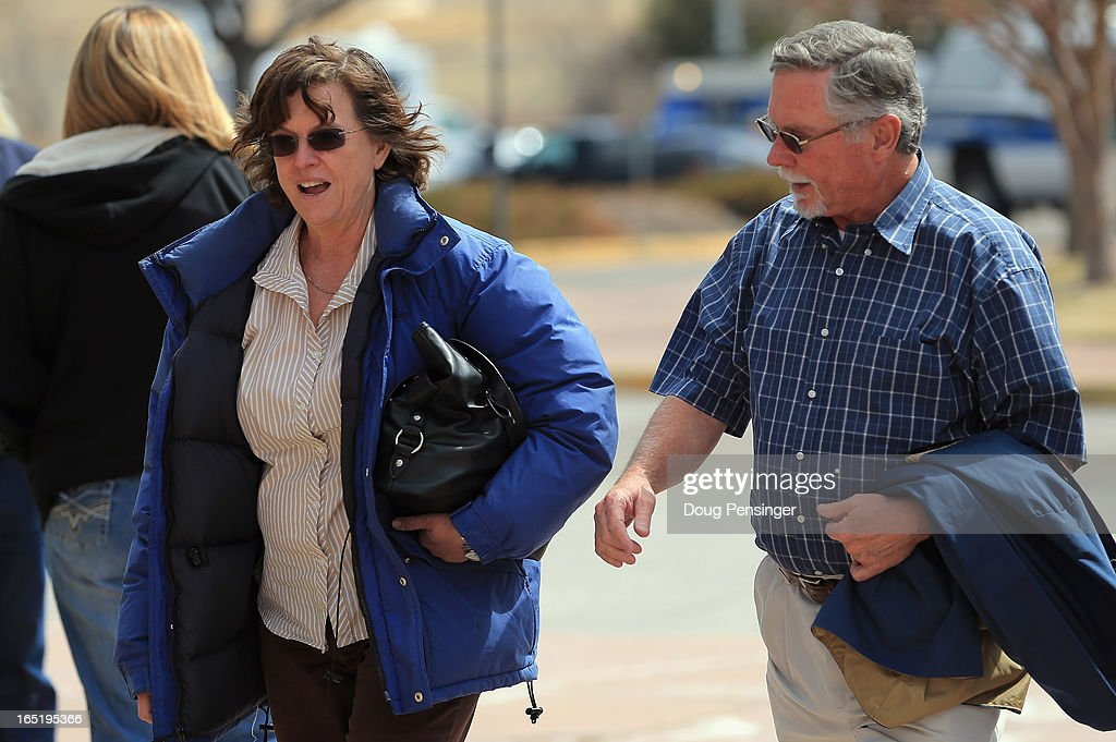 Arlene (L) and Robert Holmes, the parents of Aurora theater shooting suspect James Holmes, arrive at the court house after a midday recess during a hearing in the Arapahoe County Justice Center on April 1, 2013 in Centennial, Colorado. It was announced that District Attorney George Brauchler will seek the death penalty for suspect James Holmes who is charged with 166 counts of murder, attempted murder and other crimes in the Aurora theater shooting on July 20, 2012.