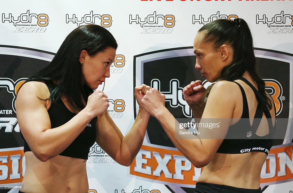 Arlene Blencowe of Australia (L) and Daniella Smith of New Zealand face off during the weigh in ahead of tomorrow night's bout between Daniella Smith and Arlene Blencowe at Trusts Stadium on June 12, 2013 in Auckland, New Zealand.