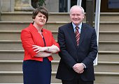 Arlene Foster and deputy first minister Martin McGuinness wait to greet Prime Minister Theresa May at Stormont on July 25 2016 in Belfast Northern...