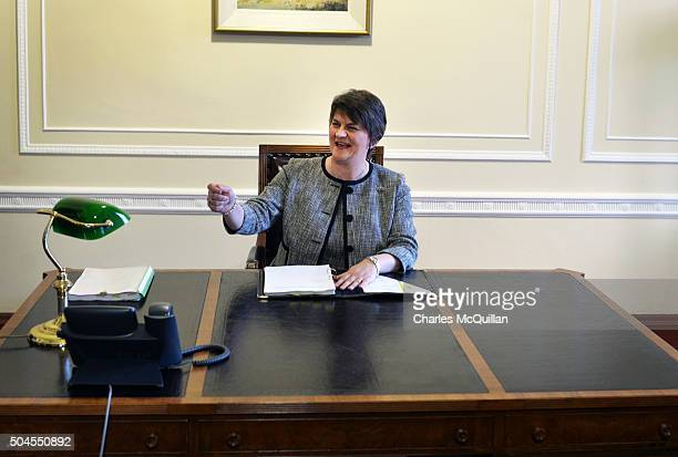 Arlene Foster asks for a pen as she takes her seat in the First Ministers office after becoming the new First Minister on January 11 2016 in Belfast...