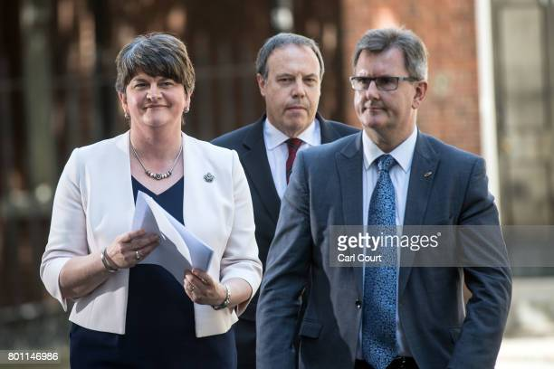 Arlene Foster the leader of Northern Ireland's Democratic Unionist Party party deputy leader Nigel Dodds and MP Jeffrey Donaldson leave after meeting...