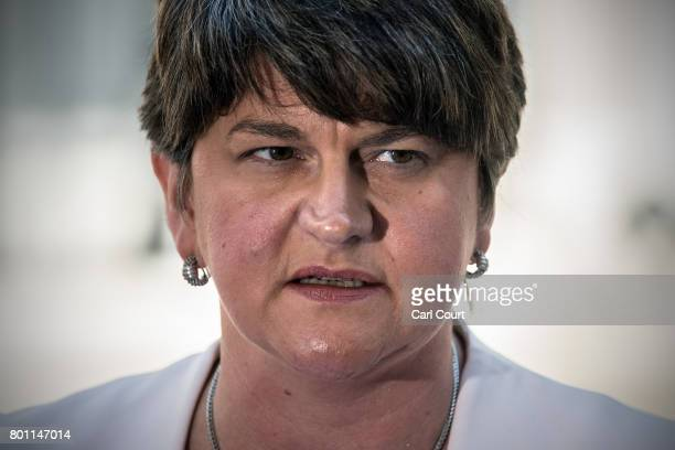 Arlene Foster the leader of Northern Ireland's Democratic Unionist Party speaks to the media as she leaves after meeting Prime Minister Theresa May...