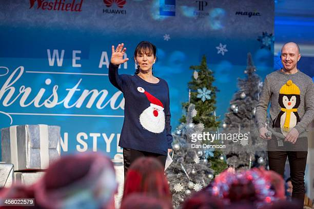 Arlene Philips leads a crowd of people in a dance routine whilst attempting to break the world record for the most people wearing Christmas jumpers...