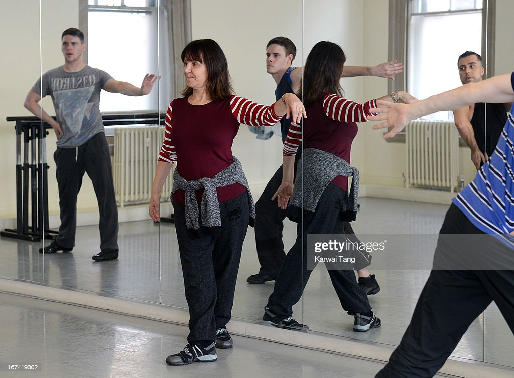 Arlene Phillips (C) choreographs and leads rehearsals of a dance routine to be performed at the Olivier Awards 2013, at The Old Finsbury Town Hall on April 25, 2013 in London, United Kingdom. The Olivier Awards 2013 with MasterCard are due to be held at the Royal Opera House on Sunday 28 April.