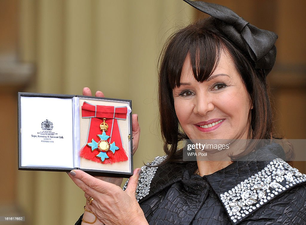 <a gi-track='captionPersonalityLinkClicked' href=/galleries/search?phrase=Arlene+Phillips&family=editorial&specificpeople=4116069 ng-click='$event.stopPropagation()'>Arlene Phillips</a> holds her Commander of the British Empire (CBE) medal after it was presented to her by Queen Elizabeth II at the Investiture Ceremony at Buckingham Palace on February 13, 2012 in London, England.