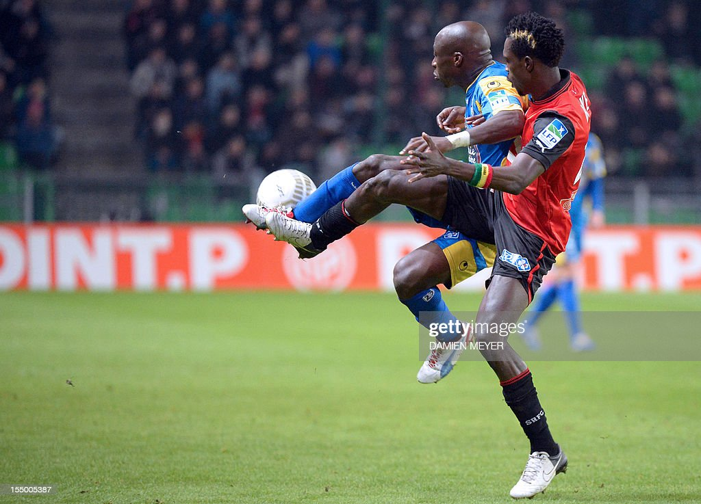 Arles Avignon's striker Haminu Draman (L) fights for the ball with Rennes' Ghanaian defender John Boye during the French League Cup football match Rennes against Avignon on October 30, 2012 at the route de Lorient stadium in Rennes, western France.