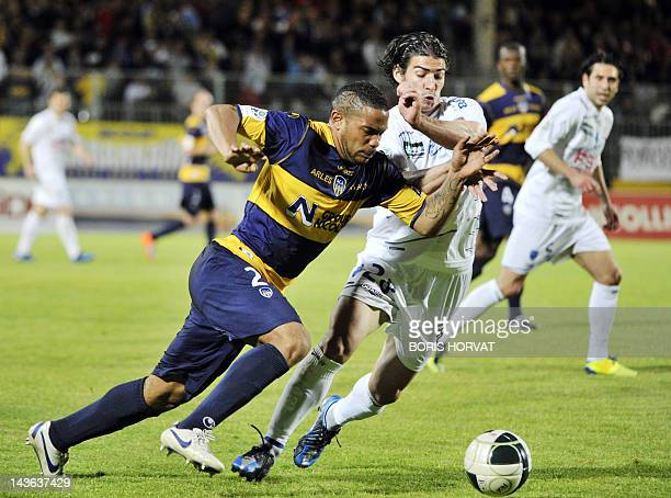 Arles' defender Vincent Acapandie vies with Troyes' forward Gregory Bettiol during their French L2 football match ArlesAvignon vs ESTAC Troyes on May...