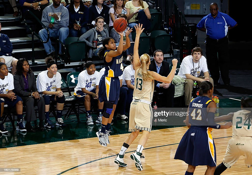 Arlesia Morse #4 of the Marquette Golden Eagles shoots over Inga Orekhova #13 of the South Florida Bulls defends during the game at the Sun Dome on January 26, 2013 in Tampa, Florida.