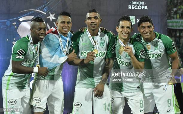 Arley Rodriguez Elkin Blanco Diego Arias and Luis Carlos Ruiz of Nacional celebrate with their medals as champions of the CONMEBOL Recopa...