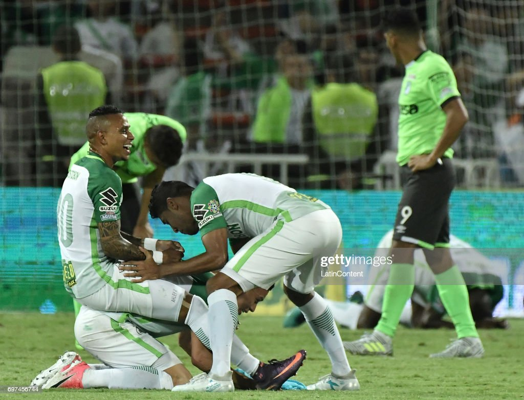 Arley Rodriguez, Luis Carlos Ruiz and Mateus Uribe of Atletico Nacional celebrate as champions of the Liga Aguila I 2017 after winning the Final second leg match between Atletico Nacional and Deportivo Cali as part of Liga Aguila I 2017 at Atanasio Girardot Stadium on June 18, 2017 in Medellin, Colombia.