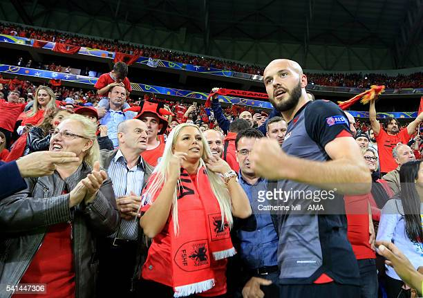 Arlind Ajeti of Albania celebrates the win with his family after the UEFA EURO 2016 Group A match between Romania and Albania at Stade des Lumieres...
