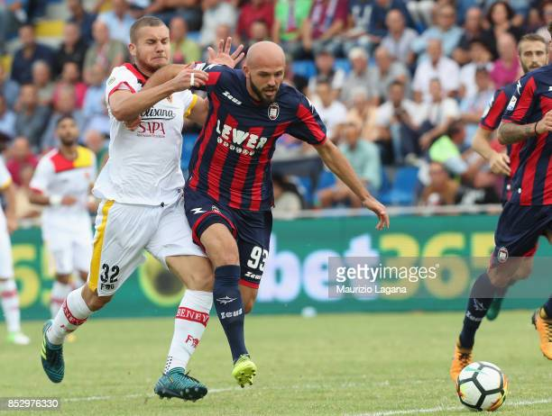Arlind Ajeti of Crotone competes for the ball with George Puscas of Benevento during the Serie A match between FC Crotone and Benevento Calcio at...