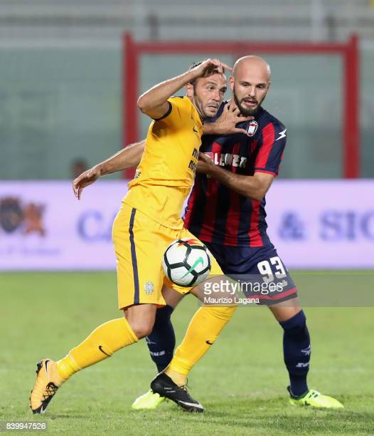 Arlind Ajeti of Crotone competes for the ball with Giampaolo Pazzini of Verona during the Serie A match between FC Crotone and Hellas Verona FC at...