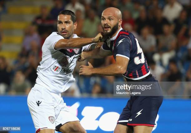 Arlind Ajeti of Crotone competes for the ball with Marco Borriello of Cagliari during the PreSeason Friendly match between FC Crotone and Cagliari...