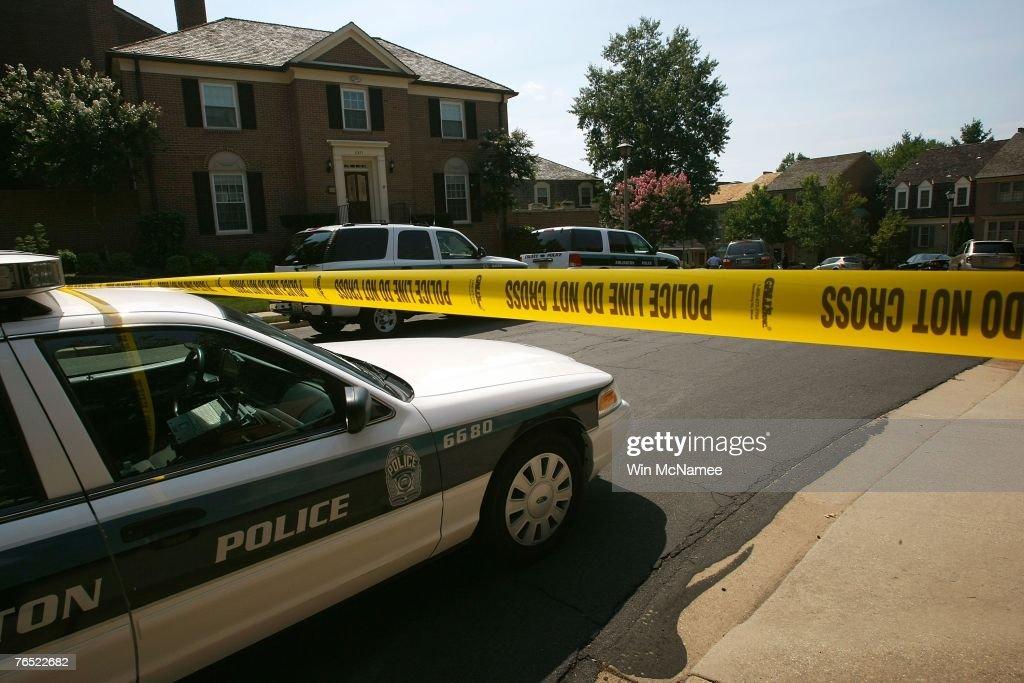 Arlington County police vehicles gather outside the home of Rep Paul Gillmor September 5 2007 in Arlington Virgiinia Gillmor was reportedly found...