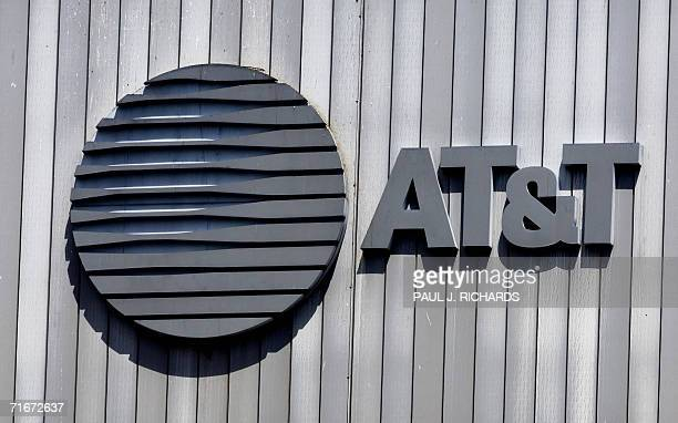 The ATT logo and initials sit atop their building 18 August in Arlington Virginia AFP PHOTO/PAUL J RICHARDS