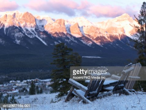 Arm chair covered by snow : Stock Photo