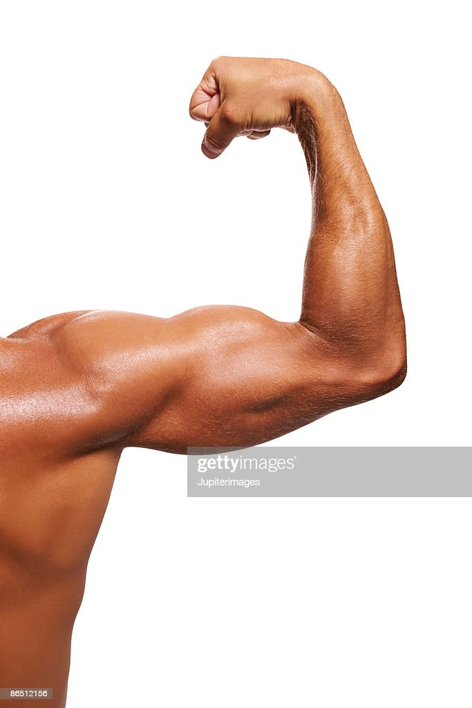 Arm flexing musles : Stock Photo