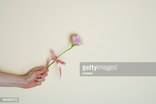 Arm holding flower