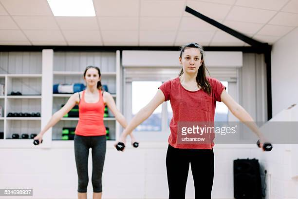 Arm lifts with hand weights in an exercise studio