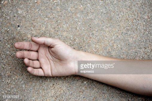 Arm on concrete
