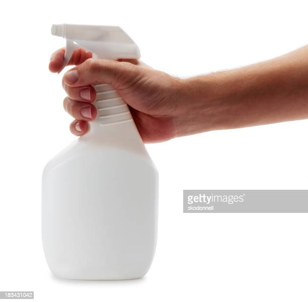 Arm Spraying a Cleaning Bottle