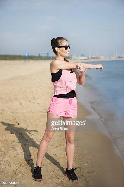 Arm stretching on the sunny beach. Gdansk, Poland