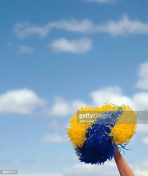 Arm waving a pompom