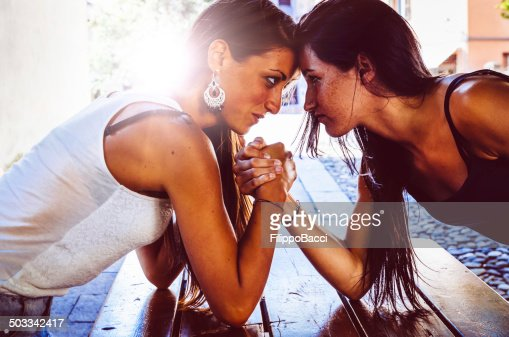 Arm Wrestling Between Two Beautiful Young Women