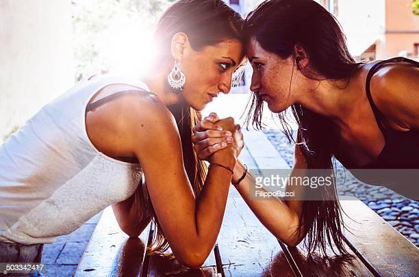 Arm Wrestling Between Two Beautiful Young Women
