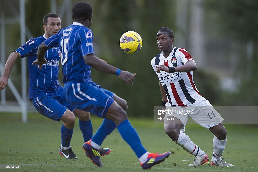 Arman Deumi of Karabukspor, Virgil Misidjan of Willem II during the match between Willem II and Karabukspor on January 10, 2013 at Belek, Turkey.