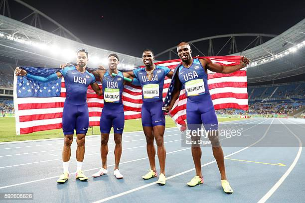Arman Hall Tony McQuay Gil Roberts and Lashawn Merritt of the United States react after winning gold in the Men's 4 x 400 meter Relay on Day 15 of...