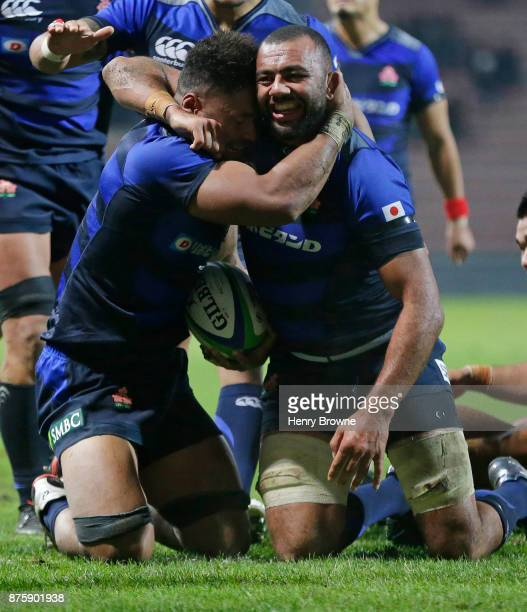 Armanaki Lelei Mafi of Japan is hugged by Michael Leitch after scoring a try during the international match between Japan and Tonga at Stade Ernest...