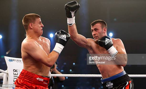 Armand Cullhaj of Albania and Tyron Zeuge of Germany exchange punches during their WBO youth super middleweight championship title fight at Sport und...