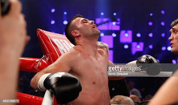 Armand Cullhaj of Albania raects after losing his WBO youth super middleweight championship title fight against Tyron Zeuge of Germany at Sport und...