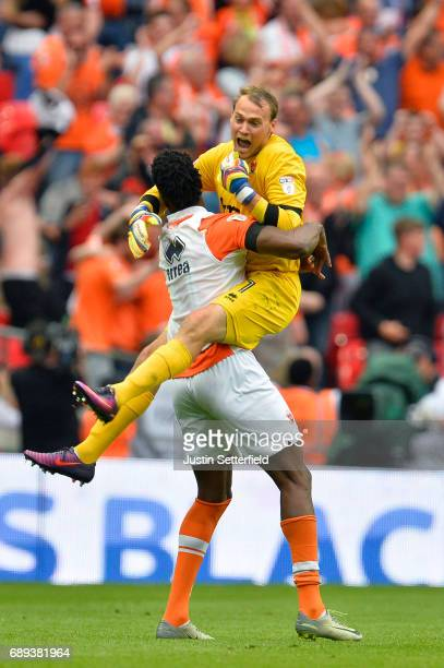 Armand Gnanduillet and Sam Slocombe of Blackpool celebrate victory and promotion after the Sky Bet League Two Playoff Final between Blackpool and...