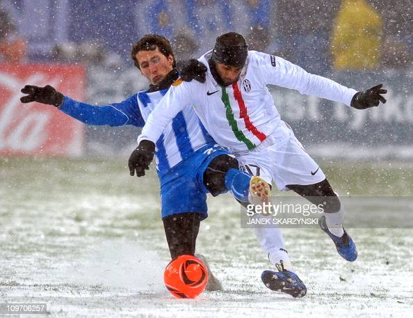 Armand Traore of Juventus fights for the ball with Marcin Kikut of Lech during UEFA Europa League match on December 1 2010 in Poznan AFP PHOTO /...