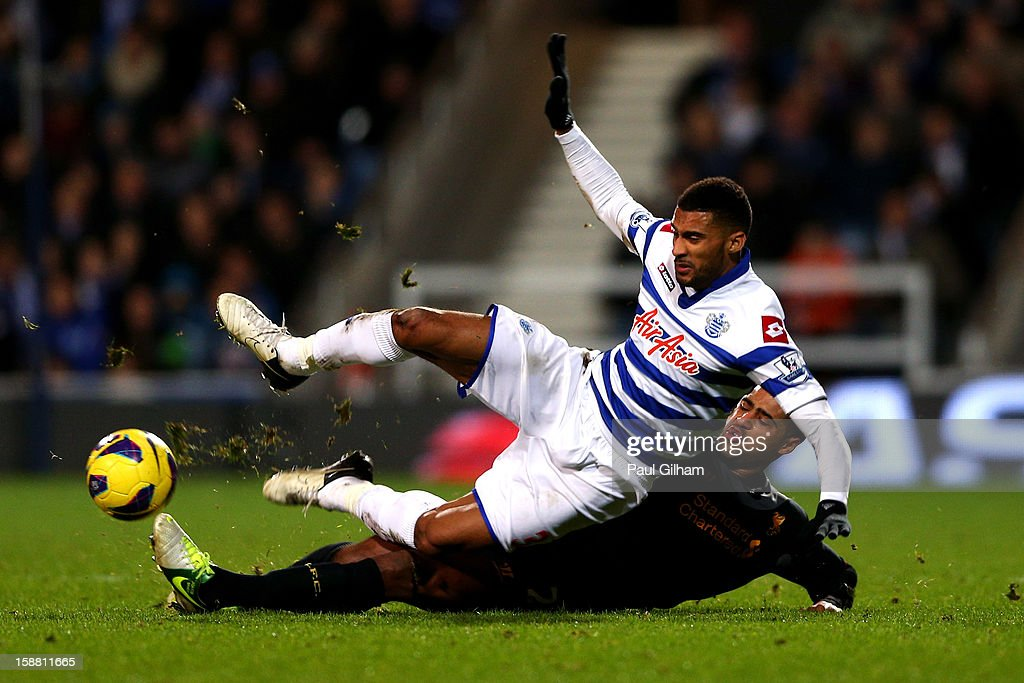 Armand Traore of QPR is tackled by <a gi-track='captionPersonalityLinkClicked' href=/galleries/search?phrase=Glen+Johnson&family=editorial&specificpeople=209192 ng-click='$event.stopPropagation()'>Glen Johnson</a> of Liverpool during the Barclays Premier League match between Queens Park Rangers and Liverpool at Loftus Road on December 30, 2012 in London, England.