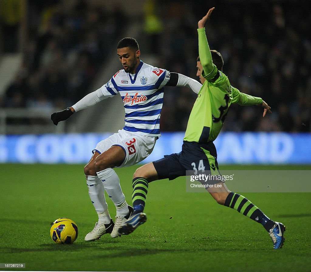 Armand Traore of Queens Park Rangers is tackled by Matthew Lowton of Aston Villa during the Barclays Premier League match between Queens Park Rangers and Aston Villa at Loftus Road on December 1, 2012 in London, England.