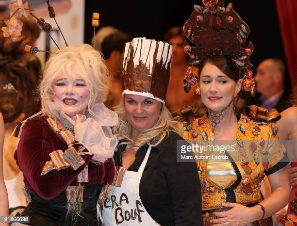 PARIS OCTOBER 13 Armande Altai and Valerie Damidot and Daniela Lumbroso displays a chocolate decorated dress during the Chocolate dress fashion show...