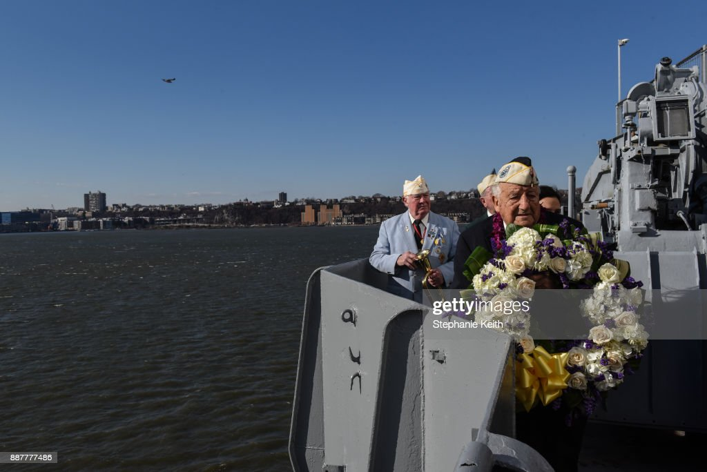 Armando 'Chick' Galella holds a wreath at a wreath-laying ceremony aboard the Intrepid Sea, Air and Space Museum the on December 7, 2017 in New York City. The 96 year old Galella was the only survivor to attend the ceremony commemorating the 76th anniversary of the attack on Pearl Harbor.