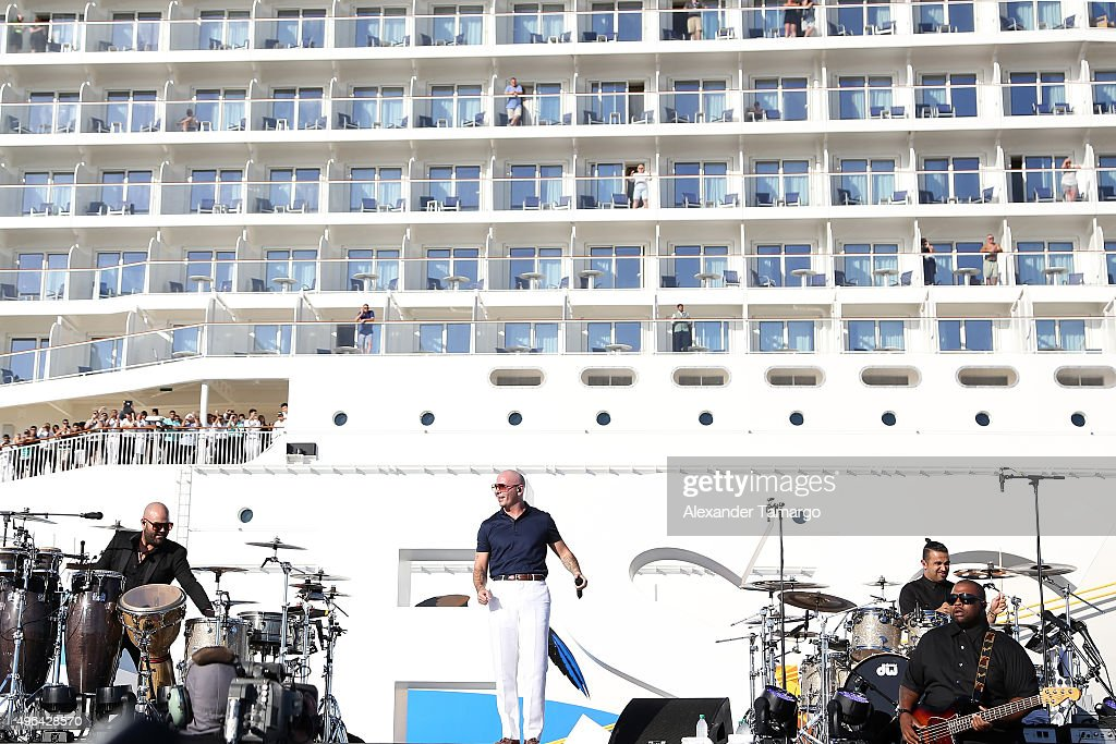 Armando Christian Perez 'Pitbull' performs onstage at the Christening Ceremony for Norwegian Cruise Line's newest ship Norwegian Escape at Port Miami...