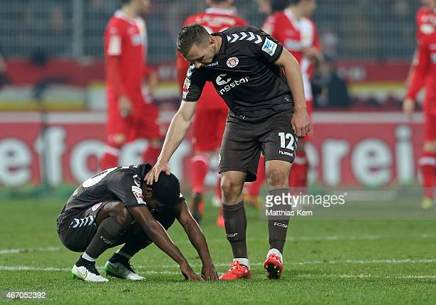 Armando Cooper of Hamburg and team mate John Verhoek show their frustration after loosing the Second Bundesliga match between 1FC Union Berlin and FC...