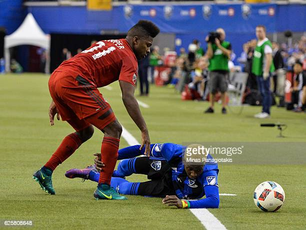 Armando Cooper of the Toronto FC challenges Ambroise Oyongo of the Montreal Impact during leg one of the MLS Eastern Conference finals at Olympic...