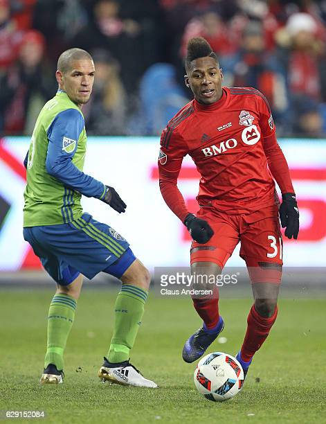 Armando Cooper of the Toronto FC plays the ball in front of Osvaldo Alonso of the Seattle Sounders during the 2016 MLS Cup at BMO Field on December...